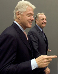 Former US President Clinton walks into a news conference with Canadian PM Martin during UN Climate Change Confererence in Montreal