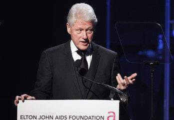 "Former U.S. President Bill Clinton speaks after accepting an award during ""An Enduring Vision,"" a benefit dinner for the Elton John Aids Foundation in New York"