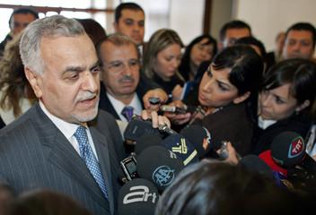 Iraq's Vice President Tareq al-Hashemi talks to media as he arrives at the Esenboga Airport in Ankara