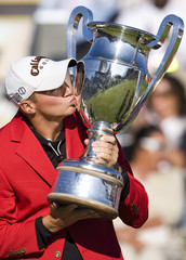 Noren of Sweden kisses the trophy after winning the European Masters golf tournament in Crans-Montana