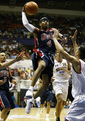 USA IVERSON DRIVES ON MEXICOS QUINTERO IN PUERTO RICO.