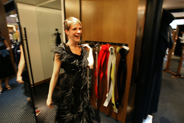 French actress Claire Perot tries on dress at Sonia Rykiel boutique before performance in Paris