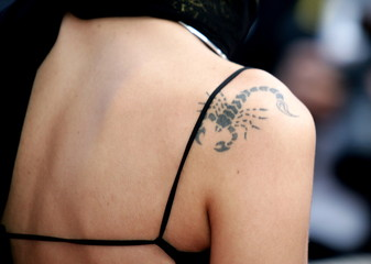 GUEST ARRIVES WITH SCORPION TATTOO ON HER SHOULDER DURING RED CARPET ARRIVALS AT 57TH CANNES FILM ...