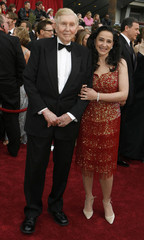 Viacom chief executive Sumner Redstone and his wife Paula Fortunato arrive at the 79th Annual Academy Awards in Hollywood