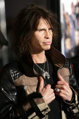 """Rock musician and cast member Steven Tyler poses for pictures at """"Be Cool"""" world premiere in Hollywood."""