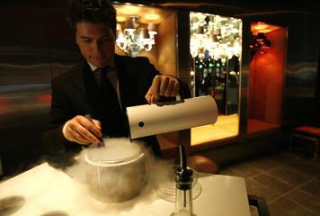 Beverage director Lucas Paya prepares a liquid nitrogen caipirinha at The Bazaar bar at the SLS hotel in Beverly Hills