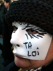 """A French prostitute wears a mask with the words """"Your Law"""" during a demonstration in Paris against a.."""