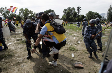 Police with batons clash with Tibetan protesters during mass sit-in protest in Kathmandu