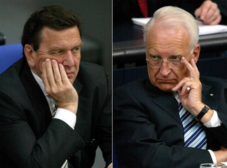 A COMBINED PICTURE SHOWS GERMAN CHANCELLOR SCHROEDER AND BAVARIANPREMIER STOIBER DURING DEBATE AT ...