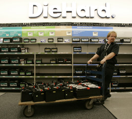 Sears employee Jim Weiher moves DieHard batteries inside a Sears store in Vernon Hills Illinois.