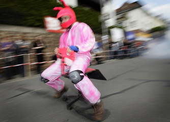 A participant speeds down a street during the first German office chair racing championship in Bad Koenig-Zell near Frankfurt