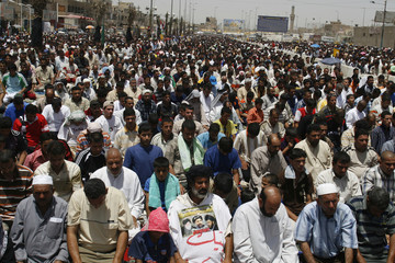 Shi'ite worshippers attend Friday prayers in Baghdad's Sadr City