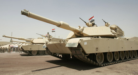Iraqi army tanks take part in a parade in Baghdad's Green Zone