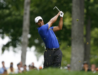 Tiger Woods tees off on 13 during the 2009 PGA Championship golf tournament at Hazeltine National Golf Club in Chaska, Minnesota