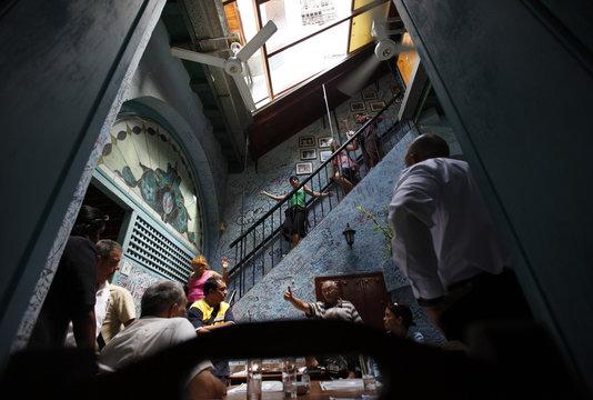 "People go down stairs in the ""Bodeguita del Medio"" bar in Old Havana"