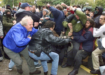POLICE OFFICERS SCUFFLE WITH PROTESTORS DURING ANTI POVERTY DEMO.