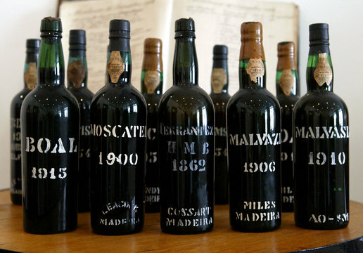 -PHOTO TAKEN 13OCT04- Several vintage Madeira wine bottles produced by the Madeira Wine Company are ..