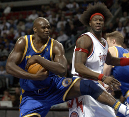 Golden State Warriors Adonal Foyle grabs the ball in front of Detroit Pistons Ben Wallace.