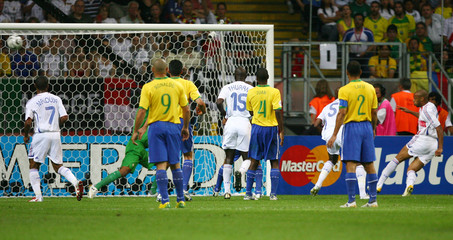 France's Henry scores his team's first goal past Brazil's Dida during their World Cup 2006 quarter-final soccer match in Frankfurt