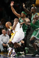 Lakers Lamar Odom drives to the basket against Celtics Paul Pierce and Kevin Garnett in the first quarter during Game 5 of the NBA Finals basketball championship in Los Angeles