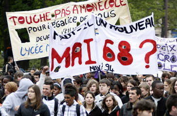 French high school student wave banners during a demonstration in Paris