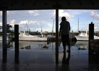Worker awaits the arrival of boats carrying stone crabs at a factory in Marathon in the Florida Keys