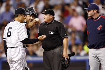 New York Yankees Manager Joe Torre talks to home plate umpire Fieldin Culbreth in New York