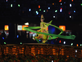 A participant performs in the opening ceremony of the Beijing 2008 Olympic Games at the National Stadium
