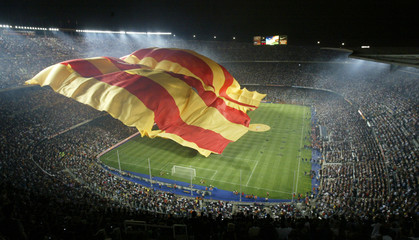 A flag claimed to be the largest in the world is unveiled in the Barcelona Nou Camp stadium during ...