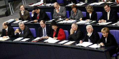 German Chancellor Merkel and her members of government attend a session of the lower house of paliament Bundestag in Berlin