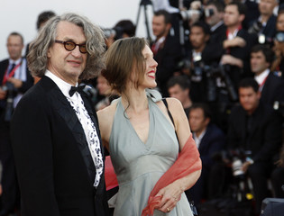 65th Venice Film Festival President Wenders of Germany and his wife Donata pose before a screening in Venice
