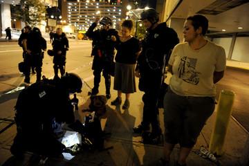 Protesters are taken into custody in downtown Denver, Colorado
