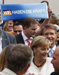 German Chancellor and CDU leader Merkel and CDU General Secretary Pofalla arrive at CDU family festival in Potsdam