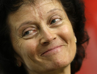 Swiss Minister of Justice Widmer-Schlumpf smiles during a news conference in Bern