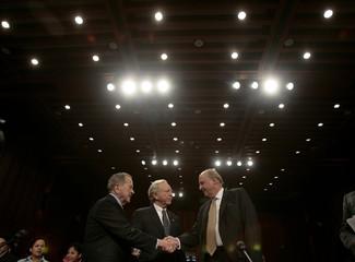Negroponte talks with U.S. Senator Lieberman and Senator Stevens at his confirmation hearings for U.S. Deputy Secretary of State on Capitol Hill in Washington