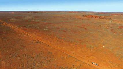 Photo sur Aluminium Rouge traffic Cordillio Downs Road - lonely vehicle Australian Outback