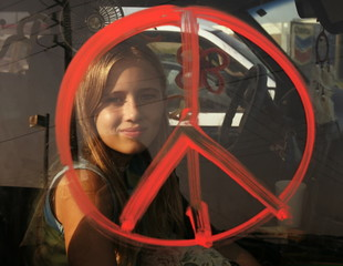 Jaycee Kane is framed by a peace symbol painted on her van in reference to Hurricane Rita as she tak..