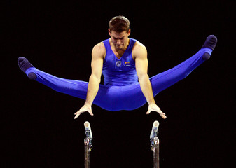 Petkovsek of Slovenia competes in the men's Parallel Bars routine at the World Gymnastic Championships in Melbourne