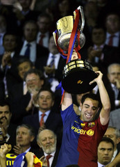 Barcelona's Hernandez lifts trophy after winning King's Cup soccer final match against Athletic Bilbao in Valencia