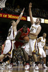 Ohio State center Oden is guarded by Minnesota guard Abu-Shamala and center Tollackson during their NCAA game in Minneapolis