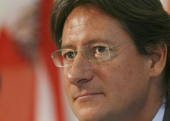 """Parliamentary faction leader of Buendnis Zukunft Oesterreich (BZOe, """"Alliance for Austrias future) party Bucher listens during a news conference in Vienna"""