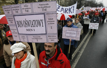 A man holds a placard during teachers' rally in Warsaw