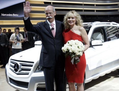 Zetsche, Chairman of the Board of Management of Daimler AG and head of Mercedes Benz poses with actress Cattrall during press days of the 2008 North American Auto Show in Detroit