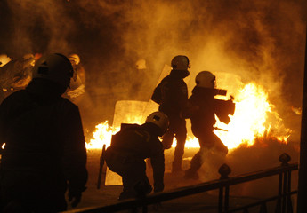 Police advance on a street clashes around Athens' Polytechnic