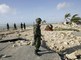 Mexican soldiers stand guard after Hurricane Dean passed through Majahual in the state of Quintana Roo
