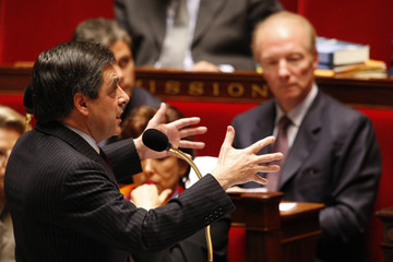 France's Prime Minister Francois Fillon delivers a speech during the questions to the government session at the National Assembly in Paris