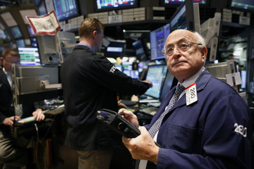 Trader Theodore Weisberg works on the floor of the New York Stock Exchange