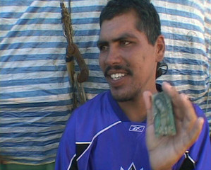 Video grab shows Mexican fisherman Lopez holding up picture of Virgin Mary after arriving in Marujo