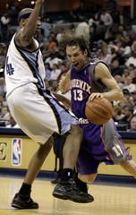 Memphis Grizzlies Watson is left behind as Phoenix Suns Steve Nash drives down court in Memphis.