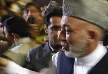 Afghan President Hamid Karzai greets supporters during an electoral rally in Kabul